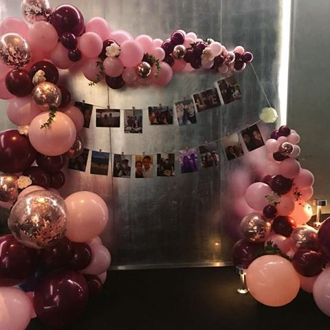 Beautiful pink and burgundy balloons for a…